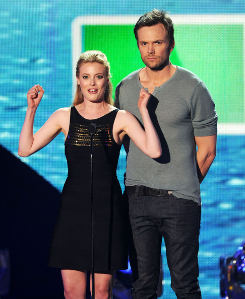 Actors Gillian Jacobs (L) and Joel McHale speak onstage during the 2011 Teen Choice Awards held at the Gibson Amphitheatre on August 7, 2011 in Universal City, California.