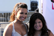 Singer Demi Lovato (L) and actress Madison De La Garza arrive at the 2011 VH1 Do Something Awards at the Hollywood Palladium on August 14, 2011 in Hollywood, California.