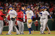 Josh Hamilton #32, Ian Kinsler #5 and Elvis Andrus #1 of the Texas Rangers celebrate after defeating the St. Louis Cardinals 2-1 during Game Two of the MLB World Series at Busch Stadium on October 20, 2011 in St Louis, Missouri.