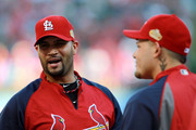 (L-R) Albert Pujols #5 and Yadier Molina #4 of the St. Louis Cardinals stand on the field during batting practice prior to Game Five of the MLB World Series against the Texas Rangers at Rangers Ballpark in Arlington on October 24, 2011 in Arlington, Texas.