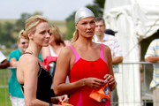 Charlene Wittstock (L) and Franziska Van Almsick (R) wait at the start of her race in the Iron Man and the Physically Challenged Event of the 2011 38th aQuelle Midmar Mile Race at Midmar Mile Dam on February 12, 2011 in Pietermaritzburg, South Africa.