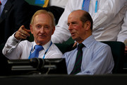 Rod Laver (L) and Prince Edward, Duke of Kent watch Novak Djokovic of Serbia and Rafael Nadal of Spain in their men's finals match during day fourteen of the 2012 Australian Open at Melbourne Park on January 29, 2012 in Melbourne, Australia.