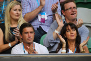 Footballer Harry Kewell and his wife Sheree Murphy watch Novak Djokovic of Serbia and Rafael Nadal of Spain in their men's finals match during day fourteen of the 2012 Australian Open at Melbourne Park on January 29, 2012 in Melbourne, Australia.