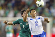 Andy Najar #14 of Honduras chases down a ball against Israel Jimenez #2 of Mexico in the 2012 CONCACAF Men's Olympic Qualifying Finals at Livestrong Sporting Park on April 2, 2012 in Kansas City, Kansas.