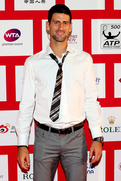 Novak Djokovic of Serbia poses for photographers before the player party during the China Open at the Intercontinental Beijing Beichen hotel on October 1, 2012 in Beijing, China.