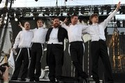 (L-R) Musicians Dr. Matt Destruction, Pelle Almqvist, Vigilante Carlstroem, Chris Dangerous, and Nicholaus Arson of The Hives perform onstage during day 3 of the 2012 Coachella Valley Music & Arts Festival at the Empire Polo Field on April 15, 2012 in Indio, California.