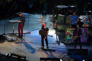 (L-R) Will Champion, Chris Martin, Jonny Buckland and .Guy Berryman of Coldplay perform during the closing ceremony on day 11 of the London 2012 Paralympic Games at Olympic Stadium on September 9, 2012 in London, England.