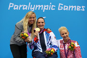 (L-R) Silver medallist Jessica Long of the United States, gold medallist Heather Frederiksen of Great Britain and bronze medallist Lesya Vladykina of Russia pose on the podium during the medal ceremony for the Women's 100m Backstroke - S8 final on day 6 of the London 2012 Paralympic Games at Aquatics Centre on September 4, 2012 in London, England.