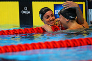 Rebecca Soni and Andrea Kropp react after they competed in the second semifinal heat of the Women's 200 m Breaststroke during Day Five of the 2012 U.S. Olympic Swimming Team Trials at CenturyLink Center on June 29, 2012 in Omaha, Nebraska.