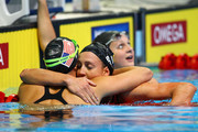 Rebecca Soni hugs Amanda Beard (L) after Soni won the Championship final of the Women's 200 m Breaststroke during Day Six of the 2012 U.S. Olympic Swimming Team Trials at CenturyLink Center on June 30, 2012 in Omaha, Nebraska.