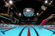 (L-R) Micah Lawrence and Rebecca Soni dive off of the starting block as they compete in the Championship final of the Women's 200 m Breaststroke during Day Six of the 2012 U.S. Olympic Swimming Team Trials at CenturyLink Center on June 30, 2012 in Omaha, Nebraska.