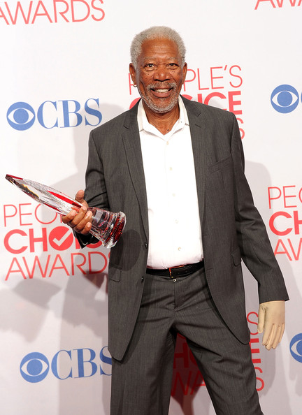 Actor Morgan Freeman poses with Favorite Movie Icon Award in the press room during the 2012 People's Choice Awards at Nokia Theatre L.A. Live on January 11, 2012 in Los Angeles, California.