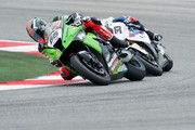 Tom Sykes of Great Britain and Kawasaki Racing Team  leads Marco Melandri of Italy and BMW Motorrad Motorsport during the Race 1 of the round 7' of the 2012 Superbike FIM World Championship at Misano World Circuit on June 10, 2012 in Misano Adriatico, Italy.