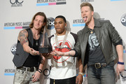Rapper Nelly (C) with singers Tyler Hubbard (L) and Brian Kelley (R) of Florida Georgia Line, winners of Single of the Year for 'Cruise,' pose in the press room during the 2013 American Music Awards at Nokia Theatre L.A. Live on November 24, 2013 in Los Angeles, California.