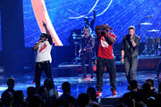 (L-R) Rappers Nelly and Ali Jones perform with singer Brian Kelley of Florida Georgia Line onstage during the 2013 American Music Awards at Nokia Theatre L.A. Live on November 24, 2013 in Los Angeles, California.