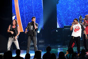 (L-R) Singers Tyler Hubbard and Brian Kelley of Florida Georgia Line perform with rappers Nelly and Ali Jones onstage during the 2013 American Music Awards at Nokia Theatre L.A. Live on November 24, 2013 in Los Angeles, California.
