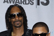 (L-R) Recording Artists Snoop Dogg and Pharrell Williams pose in the Backstage Winner's Room at Nokia Theatre L.A. Live on June 30, 2013 in Los Angeles, California.