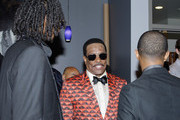 (L-R) Rapper Snoop Lion (formerly Snoop Dogg), BET Lifetime Achievement Award recipient musician Charlie Wilson and singer Pharrell Williams in the Backstage Winner's Room at Nokia Theatre L.A. Live on June 30, 2013 in Los Angeles, California.