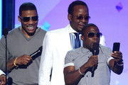 (L-R) Recording artists Nelly and Bobby Brown and actor Kevin Hart present an award onstage during the 2013 BET Awards at Nokia Theatre L.A. Live on June 30, 2013 in Los Angeles, California.