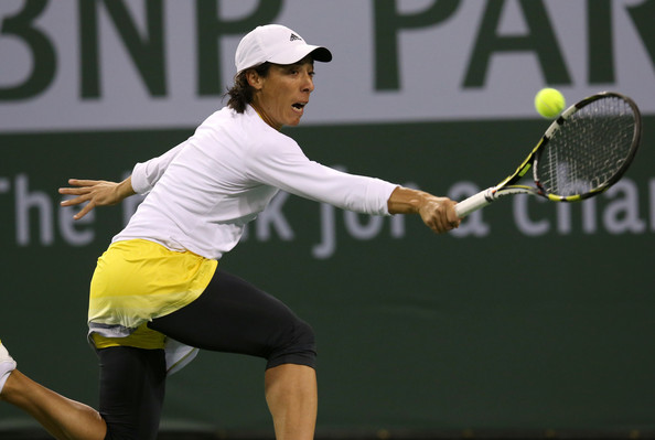 Francesca Schiavone of Italy hits a return to Maria Sharapova of Russia during day 3 of the BNP Paribas Open at Indian Wells Tennis Garden on March 8, 2013 in Indian Wells, California.