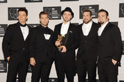 (L-R) JC Chasez, Lance Bass, Justin Timberlake, Joey Fatone and Chris Kirkpatrick of N'Sync attend the 2013 MTV Video Music Awards at the Barclays Center on August 25, 2013 in the Brooklyn borough of New York City.