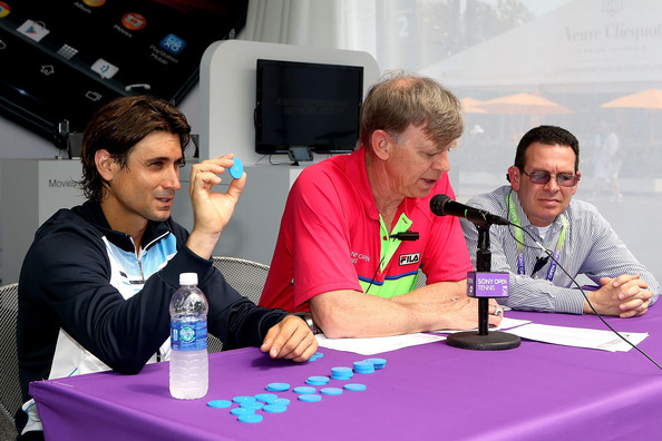 ATP World Tour player David Ferrer of Spain assists ATP Referee Mark Darby and Sony Open Tournament Director Adam Barrett with the men's draw ceremony for the Sony Open at Crandon Park Tennis Center on March 18, 2013 in Key Biscayne, Florida.