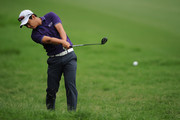 Jin Jeong of South Korea hits out of the rough on the 18th hole during day two of the 2014 Australian PGA Championship at Royal Pines Resort on December 12, 2014 on the Gold Coast, Australia.