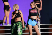 Recording artists Rita Ora (L) and Iggy Azalea perform on the Marilyn Stage during day 1 of the 2014 Budweiser Made in America Festival at Los Angeles Grand Park on August 30, 2014 in Los Angeles, California.