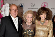 Joan Collins and Clive Davis Photos Photo