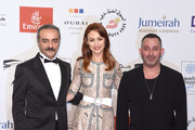 "Actors Yilmaz Erdogan, Olga Kurylenko and Cem Yilmaz attend ""The Water Diviner"" premiere during day two of the 11th Annual Dubai International Film Festival held at the Madinat Jumeriah Complex on December 11, 2014 in Dubai, United Arab Emirates."