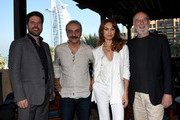 (L-R) Producer Keith Rodger, actors Yilmaz Erdogan, Olga Kurylenko and producer Andrew Mason attend 'The Water Diviner' photocall during day three of the 11th Annual Dubai International Film Festival held at the Madinat Jumeriah Complex on December 12, 2014 in Dubai, United Arab Emirates.