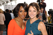 Actresses Angela Bassett (L) and Shailene Woodley attend the 2014 Film Independent Spirit Awards at Santa Monica Beach on March 1, 2014 in Santa Monica, California.