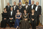 The five recipients of the 2014 Kennedy Center Honors pose for a group photo following a dinner hosted by United States Secretary of State John F. Kerry from left to right top row: David M. Rubenstein, Chairman of the John F. Kennedy Center for the Performing Arts, actor and filmmaker Tom Hanks, singer-songwriter Sting, singer Al Green, Michael Stevens, writer and producer of the annual Kennedy Center Honors and George Stevens, Jr., producer of the annual Kennedy Center Honors. From left to right bottom row: Deborah F. Rutter, President of the John F. Kennedy Center for the Performing Arts, United States Secretary of State John F. Kerry, ballerina Patricia McBride, comedienne Lily Tomlin and Teresa Heinz Kerry, wife of Secretary Kerry at the U.S. Department of State on December 6, 2014 in Washington, D.C.