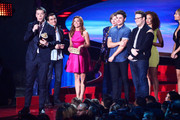 (L-R) Actors Will Poulter, Dave Franco, Peyton McCormick, Sandra Daubert, Zac Efron, Seth Rogen and Tiffany Luce speak onstage at the 2014 MTV Movie Awards at Nokia Theatre L.A. Live on April 13, 2014 in Los Angeles, California.
