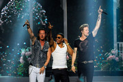 Singer Nelly (center) performs with Tyler Hubbard (L) and Brian Kelley (R) of Florida Georgia Line during the 2014 Miss USA Competition at The Baton Rouge River Center on June 8, 2014 in Baton Rouge, Louisiana.