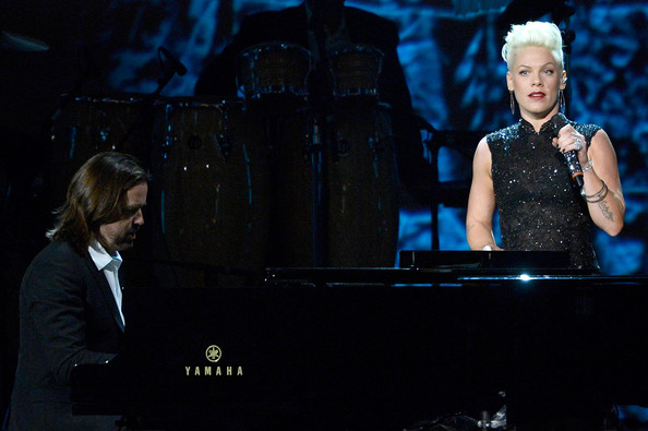 Singer Pink (R) and pianist Paul Mirkovich perform onstage at The 2014 MusiCares Person Of The Year Gala Honoring Carole King at Los Angeles Convention Center on January 24, 2014 in Los Angeles, California.
