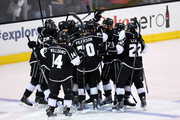 Dustin Brown #23 of the Los Angeles Kings celebrates his double overtime game winner with teammates as the Kings defeat the New York Rangers 5-4 during Game Two of the 2014 NHL Stanley Cup Final at the Staples Center on June 7, 2014 in Los Angeles, California.