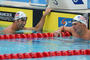 Michael Phelps and Ryan Lochte of the USA talk after swimming the Men's 200m IM heats during day four of the 2014 Pan Pacific Championships at Gold Coast Aquatics on August 24, 2014 in Gold Coast, Australia.