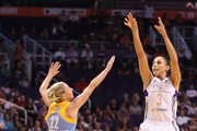 Diana Taurasi #3 of the Phoenix Mercury puts up a shot over Courtney Vandersloot #22 of the Chicago Sky during the first half of game two of the WNBA Finals at US Airways Center on September 9, 2014 in Phoenix, Arizona.  NOTE TO USER: User expressly acknowledges and agrees that, by downloading and or using this photograph, User is consenting to the terms and conditions of the Getty Images License Agreement.