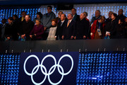 (L-R) Anne Rogge, husband former International Olympic Committee (IOC) President Jacques Rogge, Yoo Soon-taek, Claudia Bach, UN Secretary General Ban Ki-moon, IOC President Thomas Bach and Russian President Vladimir Putin stand during the Opening Ceremony of the Sochi 2014 Winter Olympics at Fisht Olympic Stadium on February 7, 2014 in Sochi, Russia.