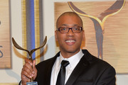 """Writer Vincent Brown, winner of the """"Outstanding Script Children's - Episodic & Specials"""" award for """"A.N.T. Farm: InfluANTces poses in the press room at the 2014 Writers Guild Awards L.A. Ceremony at J.W. Marriott at L.A. Live on February 1, 2014 in Los Angeles, California."""