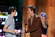 (L-R) Actor Nat Wolff, Ansel Elgort, and host Kelly Oscourne onstage at the 2014 Young Hollywood Awards brought to you by Samsung Galaxy at The Wiltern on July 27, 2014 in Los Angeles, California. The Young Hollywood Awards will air on Monday, July 28 8/7c on The CW.