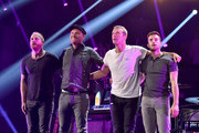 (L-R) Recording artists Will Champion, Jonny Buckland, Chris Martin and Guy Berryman of the band Coldplay perform onstage during the 2014 iHeartRadio Music Festival at the MGM Grand Garden Arena on September 19, 2014 in Las Vegas, Nevada.