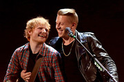 Musicians Ed Sheeran (L) and Macklemore perform onstage during the 2014 iHeartRadio Music Festival at the MGM Grand Garden Arena on September 20, 2014 in Las Vegas, Nevada.