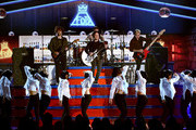 (L-R) Recording artists Joe Trohman, Patrick Stump, Andy Hurley and Pete Wentz of Fall Out Boy perform onstage during the 2015 Billboard Music Awards at MGM Grand Garden Arena on May 17, 2015 in Las Vegas, Nevada.