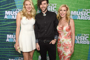 (L-R) Ashley Campbell, Cal Campbell, and Kim Campbell attend the 2015 CMT Music awards at the Bridgestone Arena on June 10, 2015 in Nashville, Tennessee.
