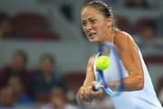 Bojana Jovanovski of Serbia plays a backhand in her match against Caroline Wozniacki of Denmark during day two of the 2015 China Open at the China National Tennis Centre on October 4, 2015 in Beijing, China.