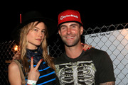 Model Behati Prinsloo (L) and musician Adam Levine attend day 1 of the 2015 Coachella Valley Music & Arts Festival (Weekend 1) at the Empire Polo Club on April 10, 2015 in Indio, California.