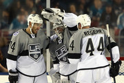 Dwight King #74, Jonathan Quick #32 and Robyn Regehr #44 of the Los Angeles Kings celebrate their victory over the San Jose Sharks during the 2015 Coors Light NHL Stadium Series game at Levi's Stadium on February 21, 2015 in Santa Clara, California. The Kings defeated the Sharks 2-1.