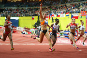 Dafne Schippers of Netherlands (2R) crosses the line to win gold ahead of silver medallist Dina Asher-Smith of Great Britain & Northern Ireland (C) and bronze medallist Verena Sailer of Germany (R) the Women's 60 metres Final during day three of the 2015 European Athletics Indoor Championships at O2 Arena on March 8, 2015 in Prague, Czech Republic.